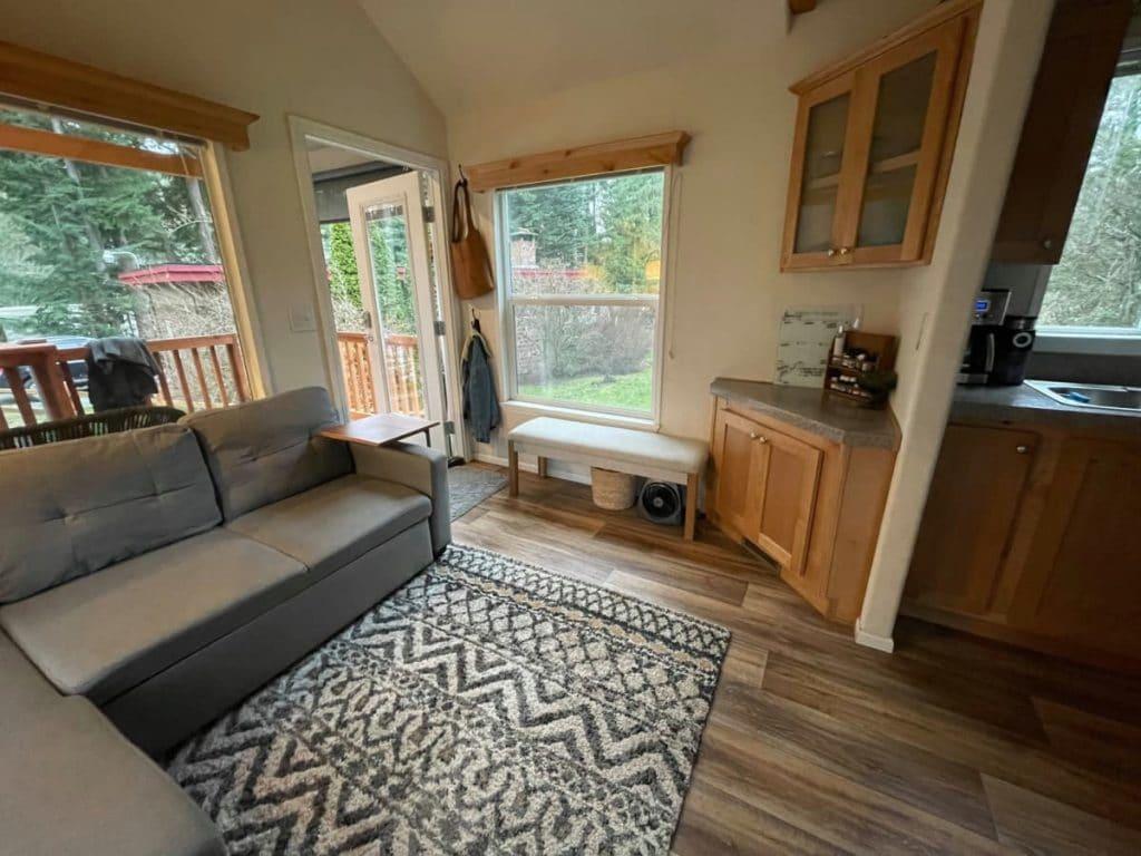 Sofa on chevron rug in tiny living room