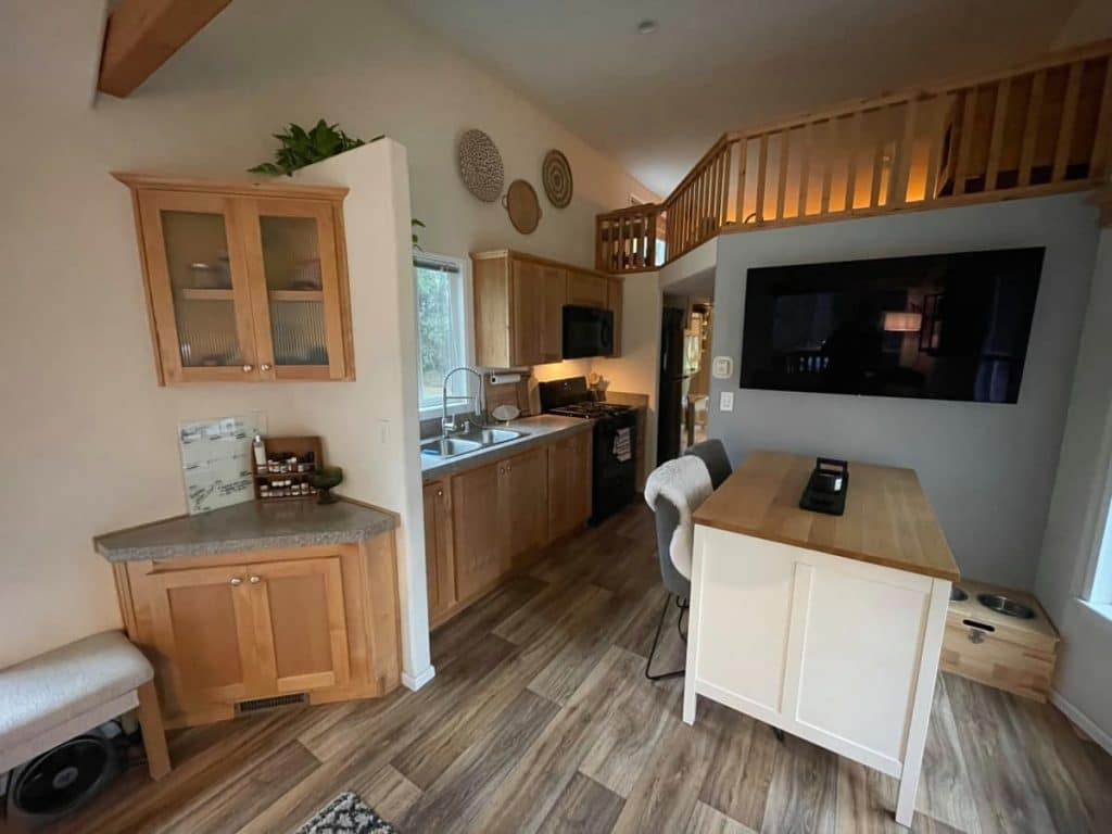 View into kitchen showing corner cabinet and island