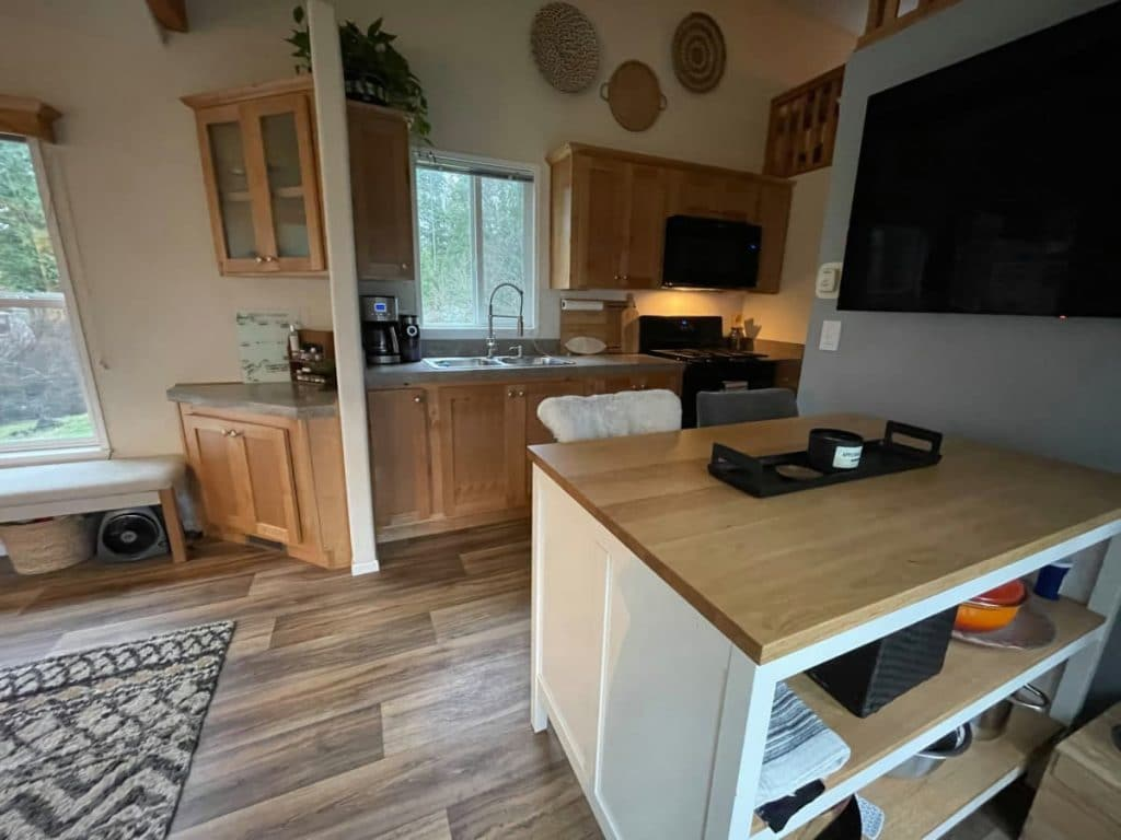 Kitchen work table with chair on reclaimed wood floor