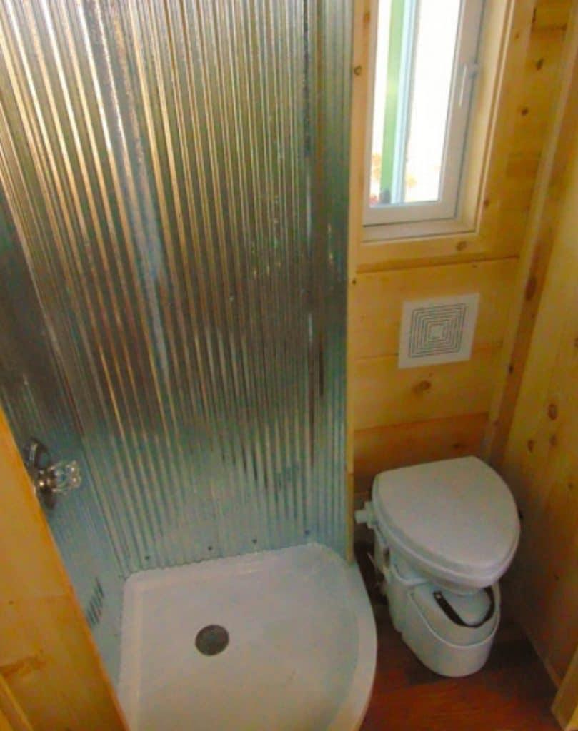 Corrugated metal shower frame in bathroom