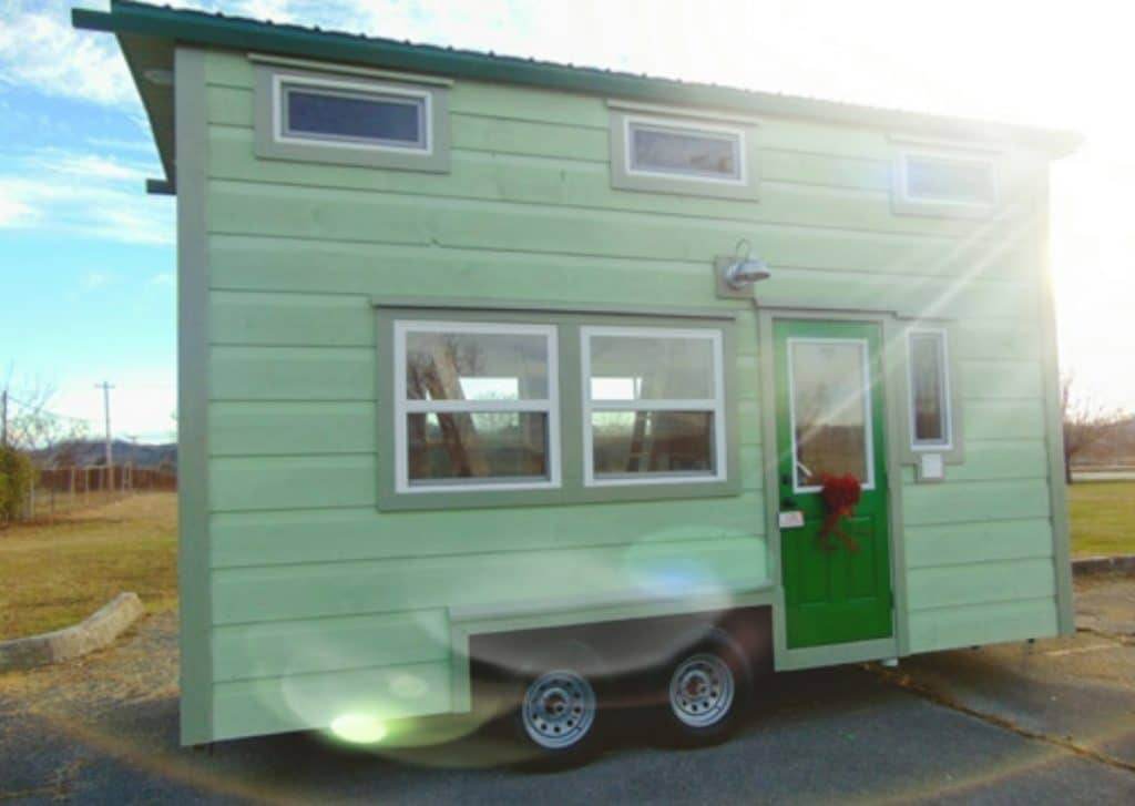 Front of light green tiny home on wheels