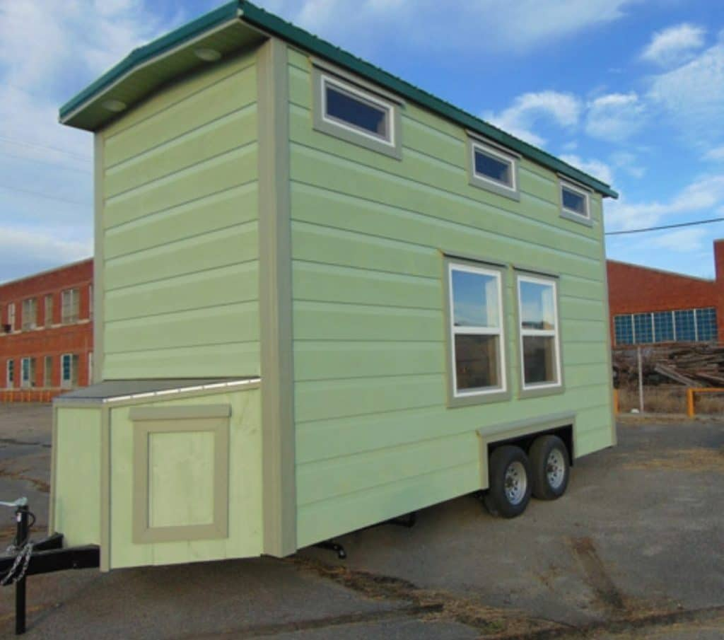 Side of light green tiny home