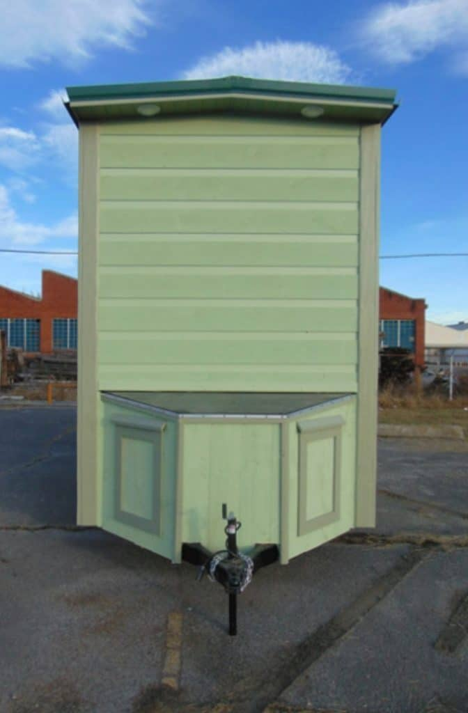 Back end of light green tiny home
