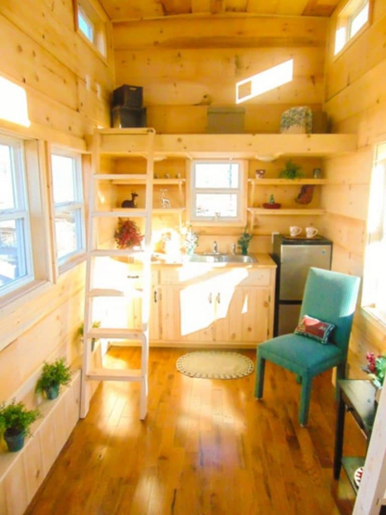 Blonde wood walls in living room of tiny home