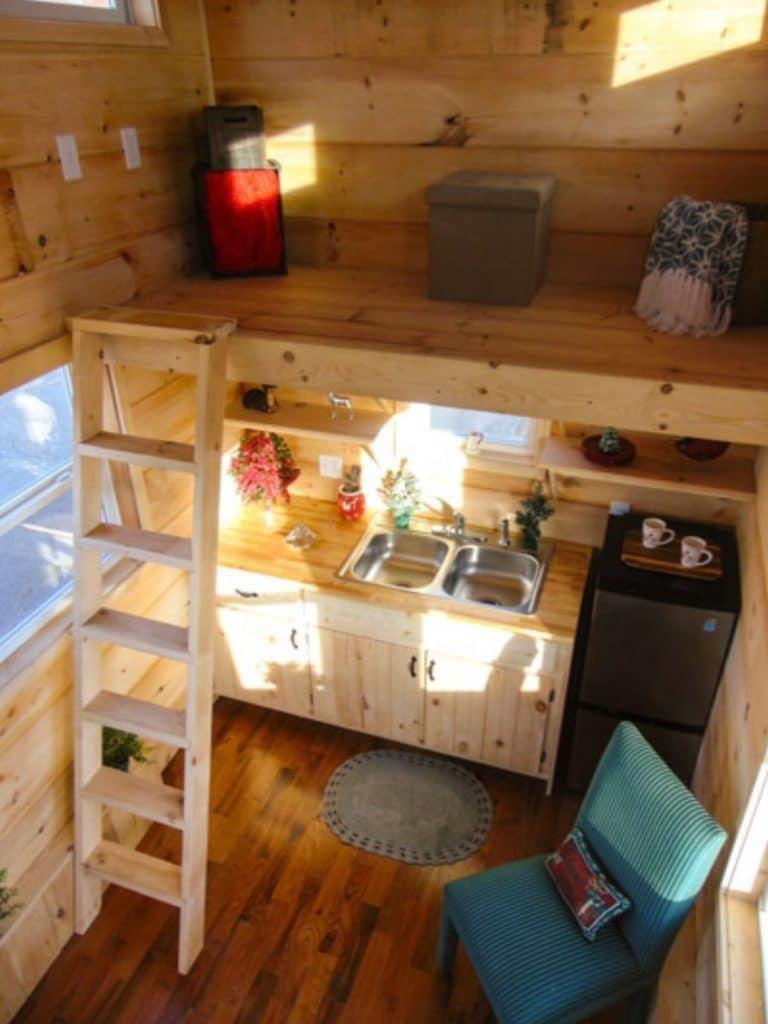Loft above kitchen area of tiny home