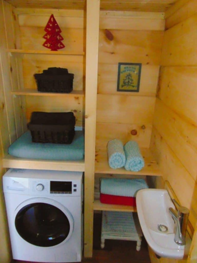 Washing machine under wooden shelves