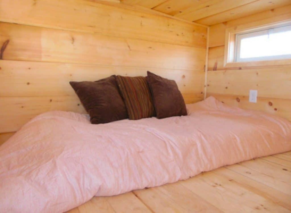 Pink bedding on loft bed