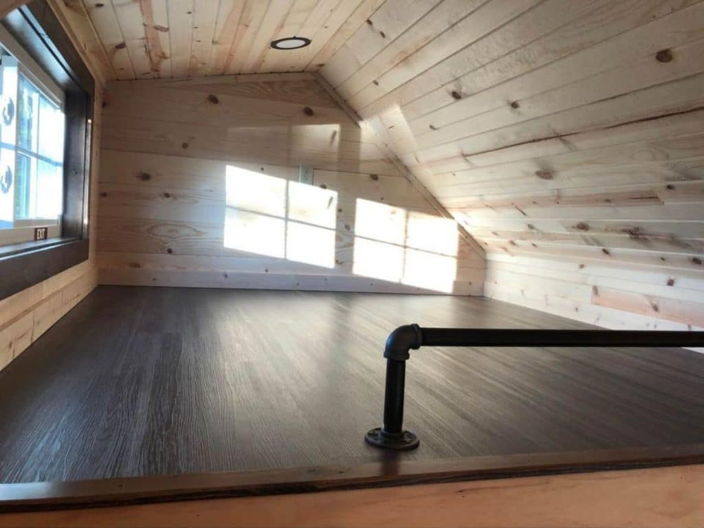 Angled roof open loft with black matte rail