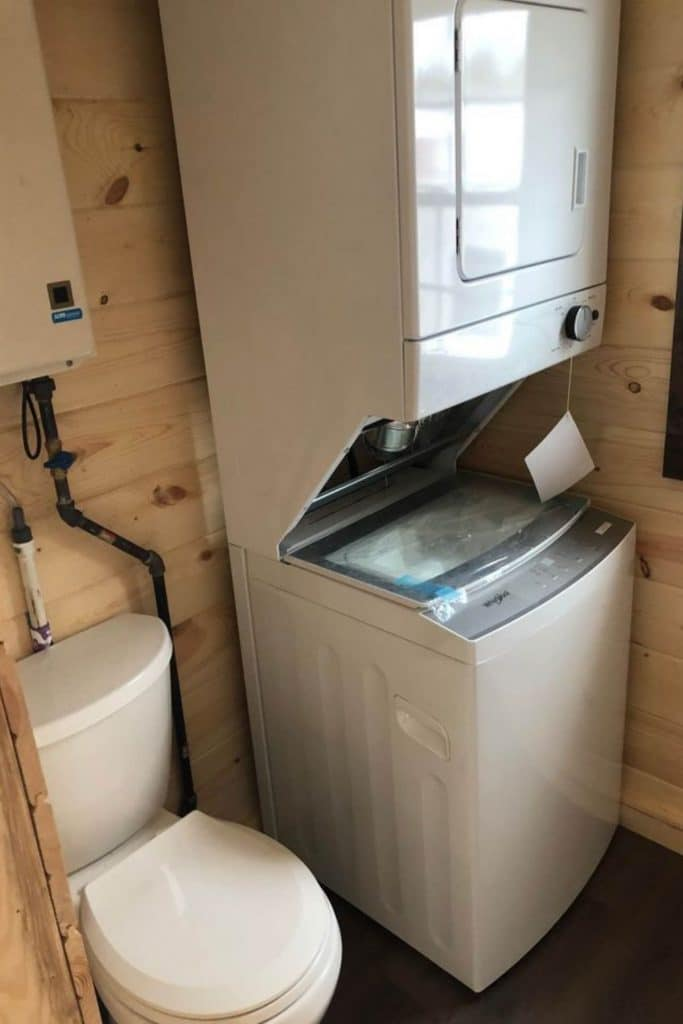 Stacking washer and dryer in bathroom next to toilet
