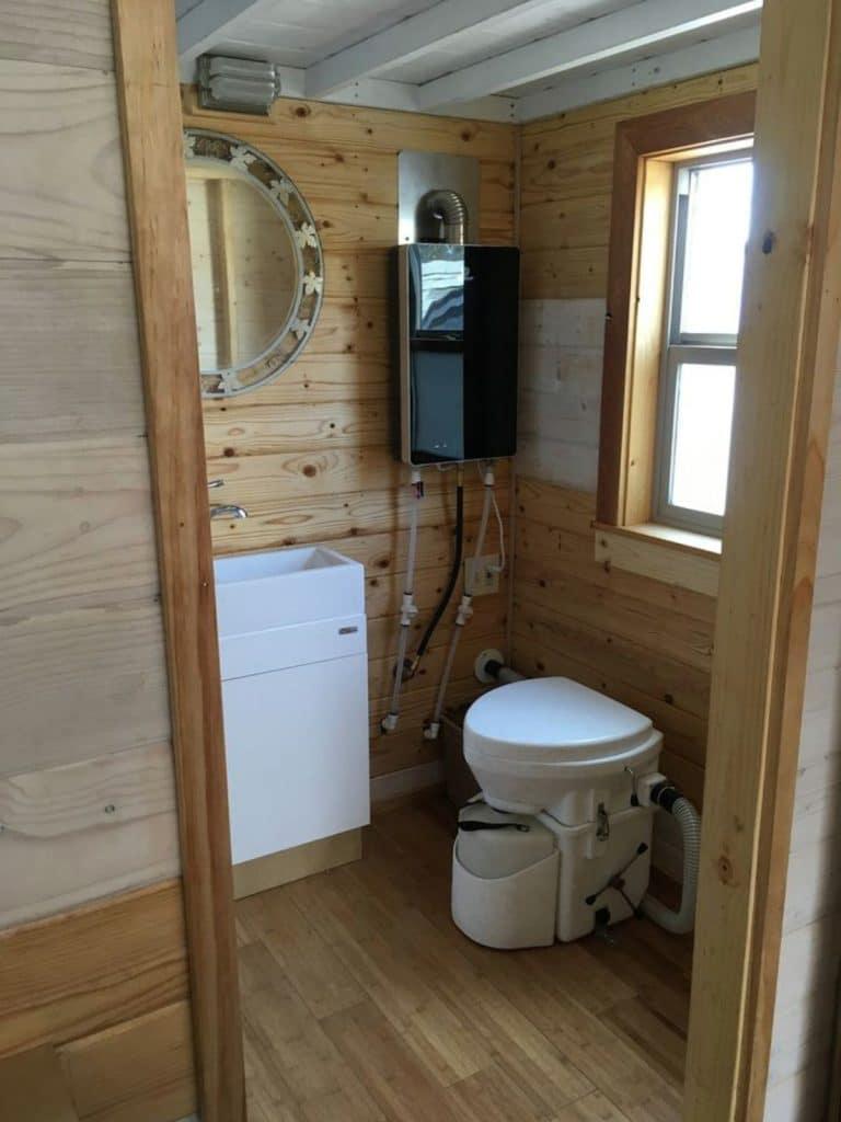 Door into bathroom showing side of vanity and compost toilet