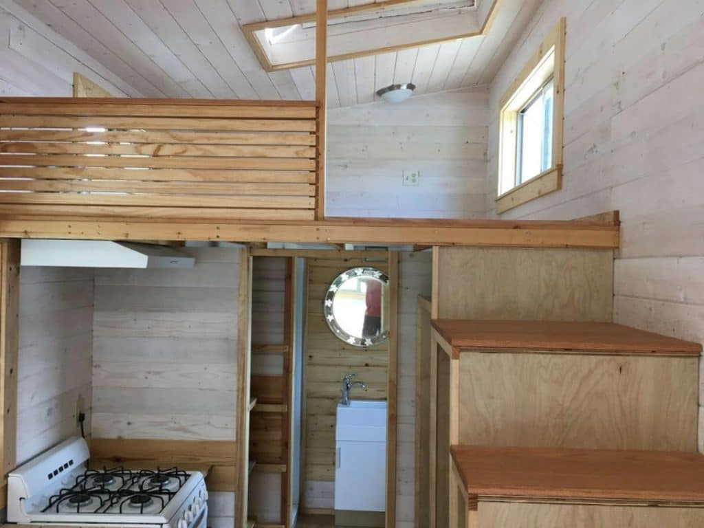 Stairs up to loft with open half wall