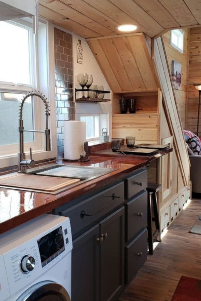 Kitchen counter with farmhouse sink and stained wood countertop