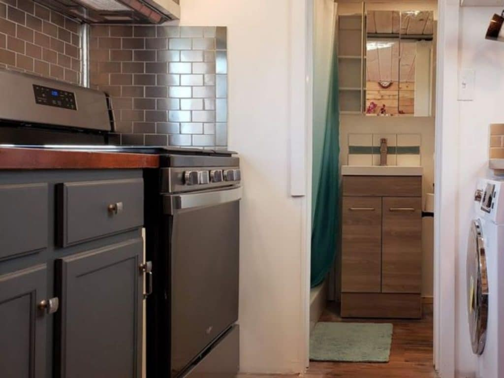 Black stove against gray subway tile wall