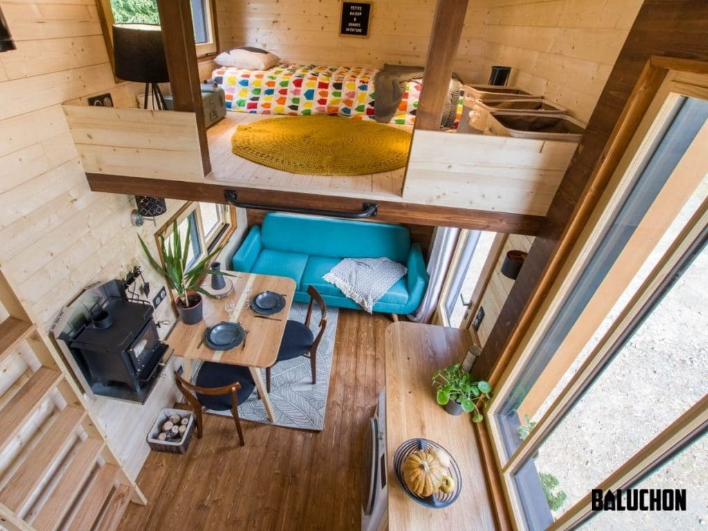 Tiny house loft with twin bed and colorful duvet