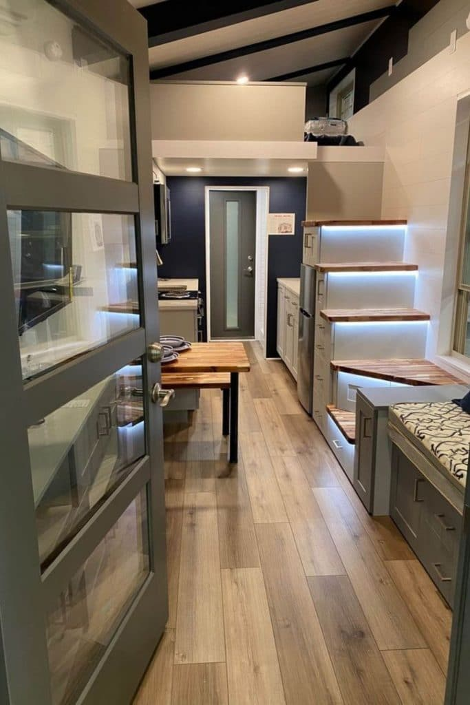 View from open front door into tiny home showing middle space