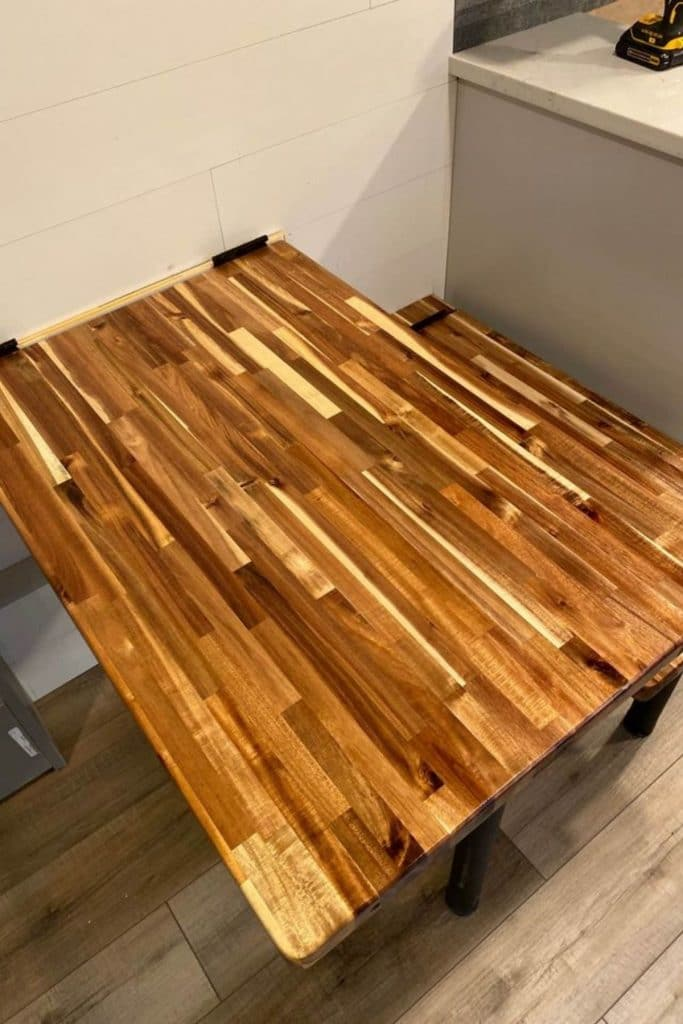 Stained table and bench seats in kitchen
