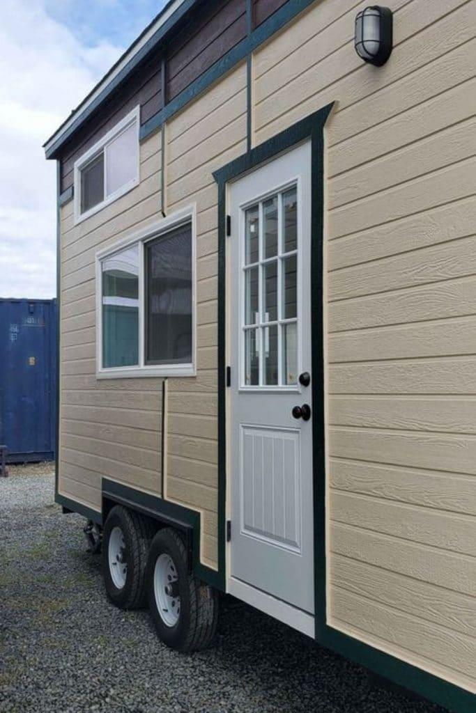 White door in cream siding