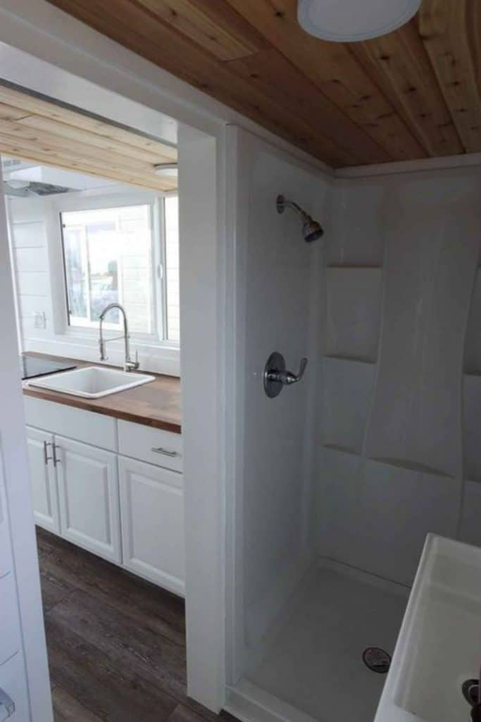 White stall shower in tiny bathroom