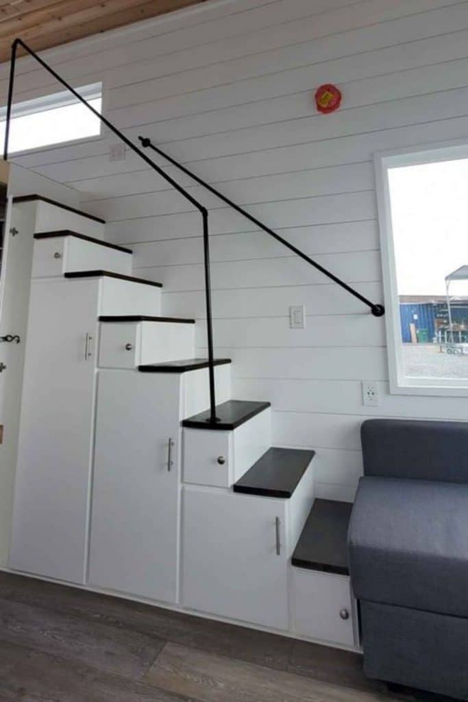 White cabinets under the stairs to loft