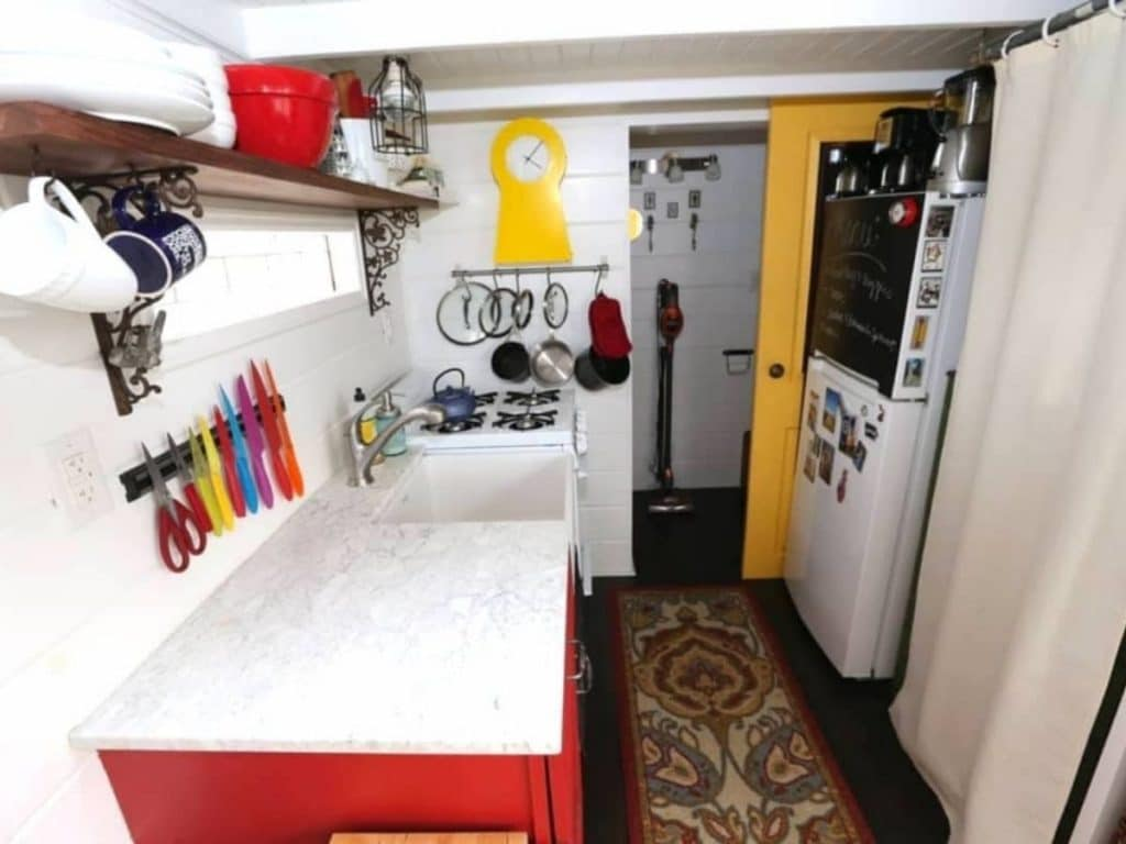 White counter and red cabinet in tiny house