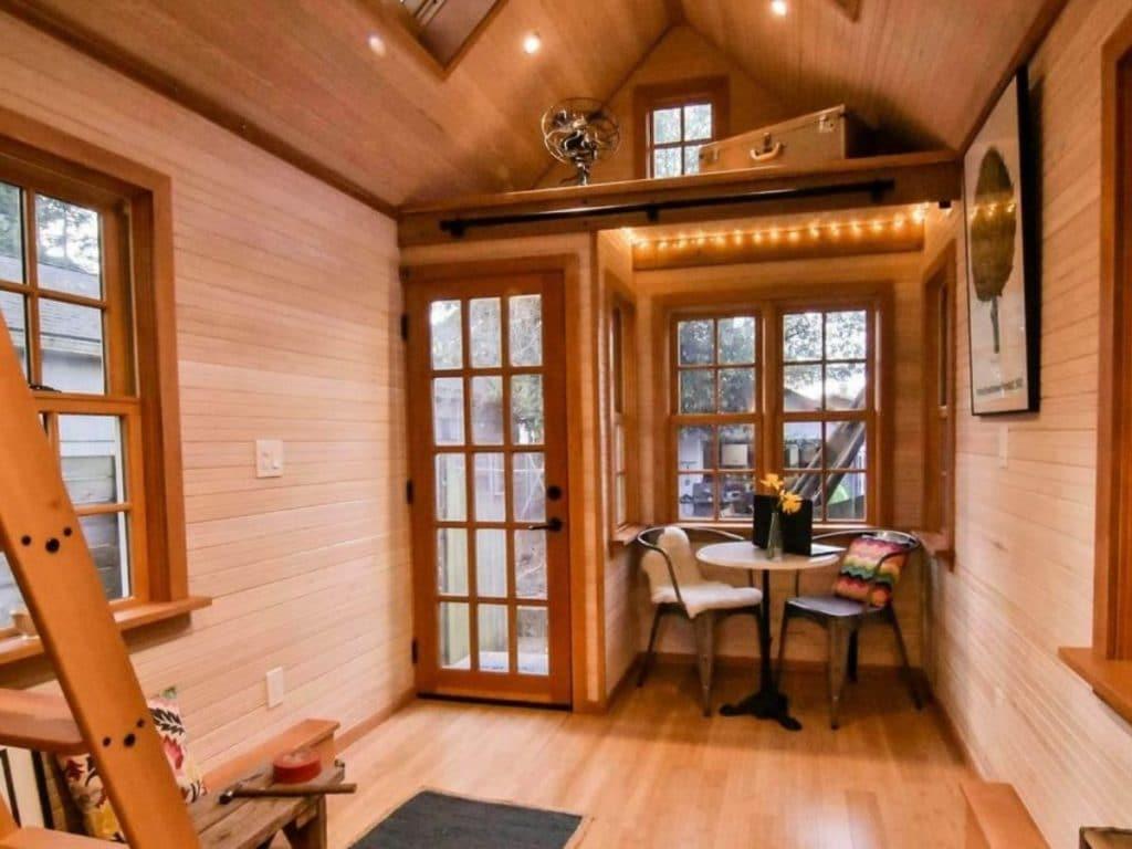 View of glass panel front door and breakfast nook