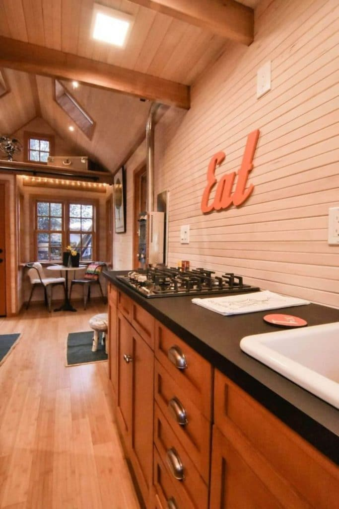 View from kitchen into tiny home living room