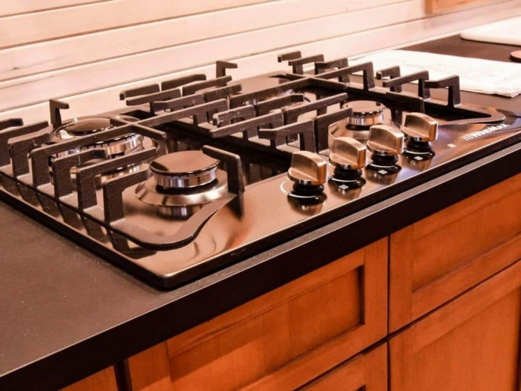 Gas cook top with black and stainless steel