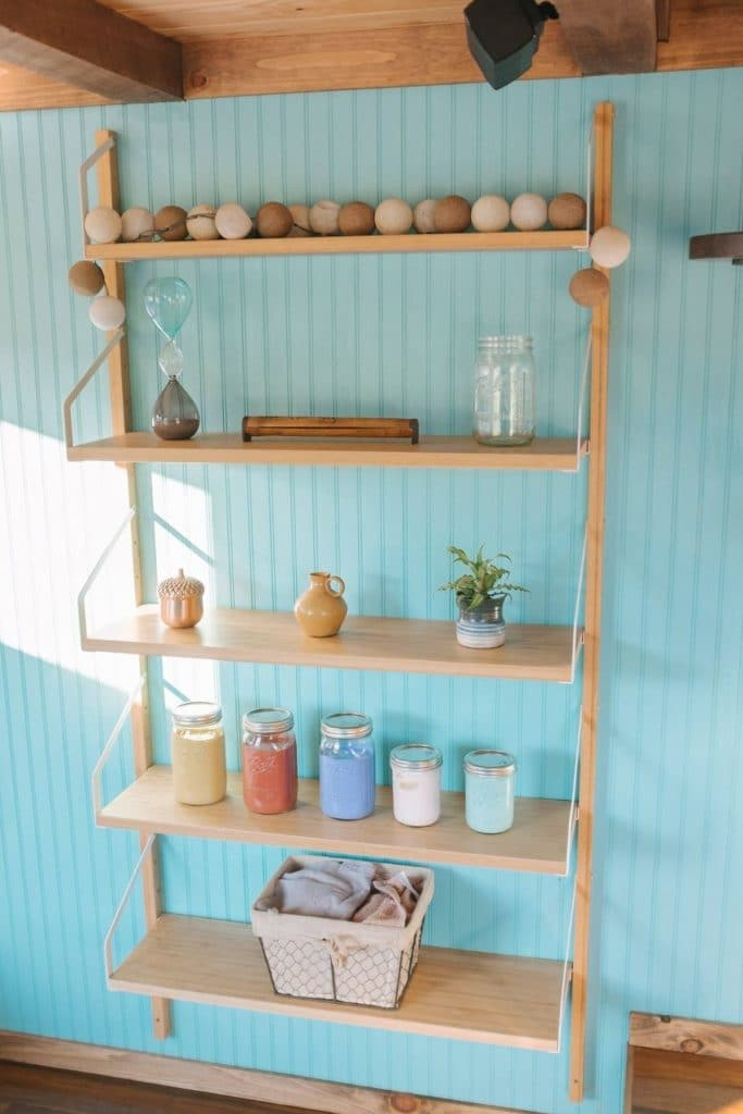 Wooden shelves against blue wall in living area