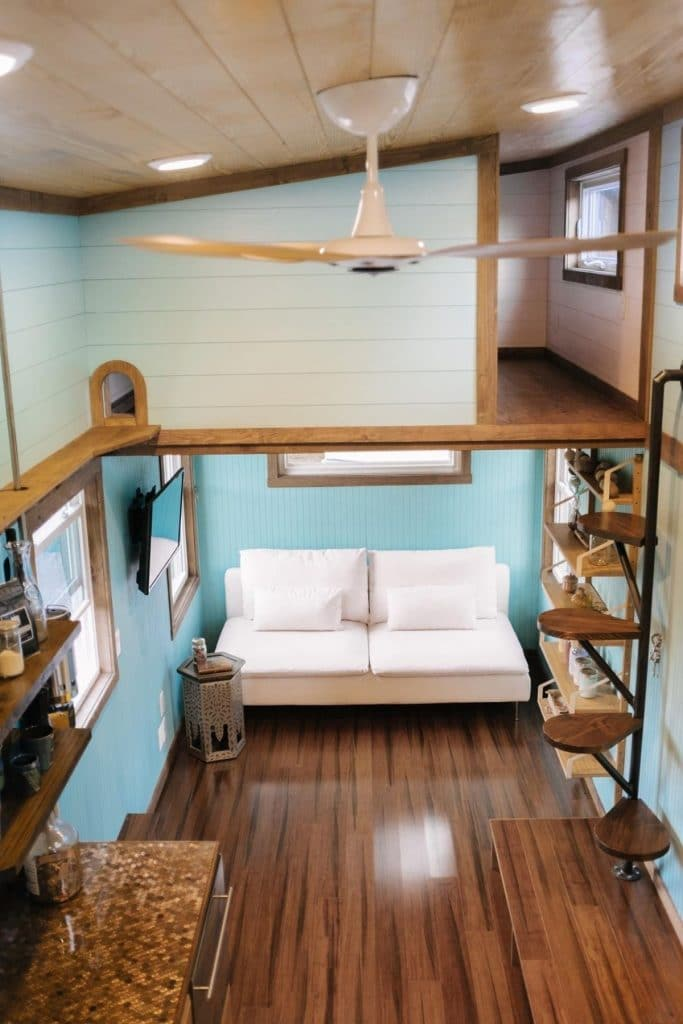 View across tiny house loft showing ceiling fan