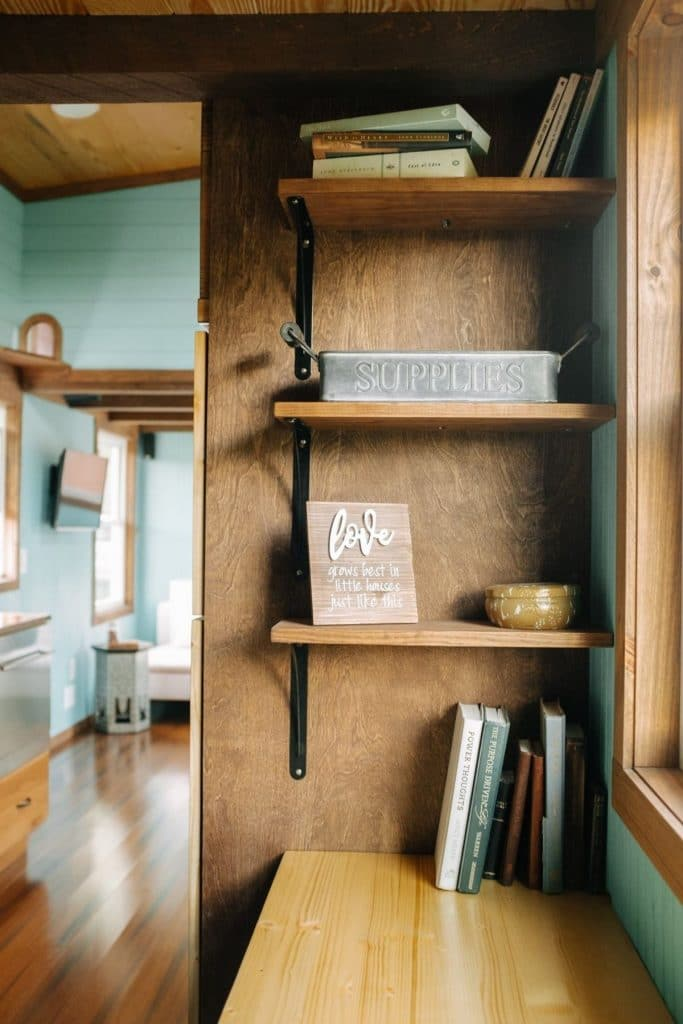 Bookshelf against stair backing in tiny workspace