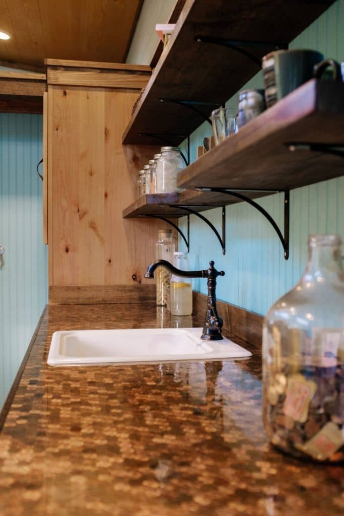 View of tiny house counter with penny top