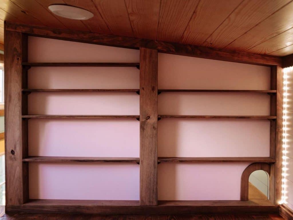 Built-in shelves on loft wall