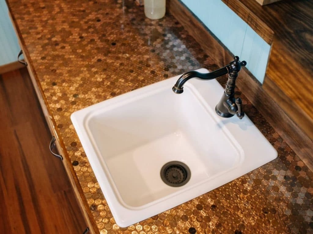 White sink in penny counter