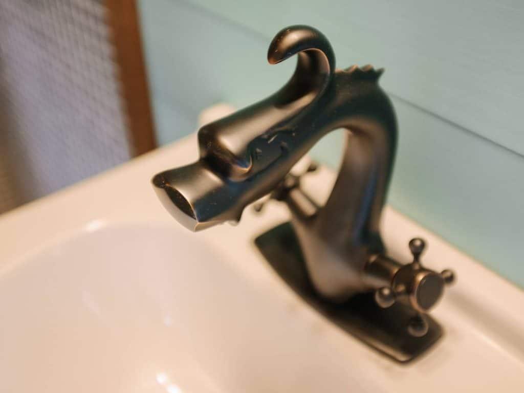 Dragon faucet on bathroom sink