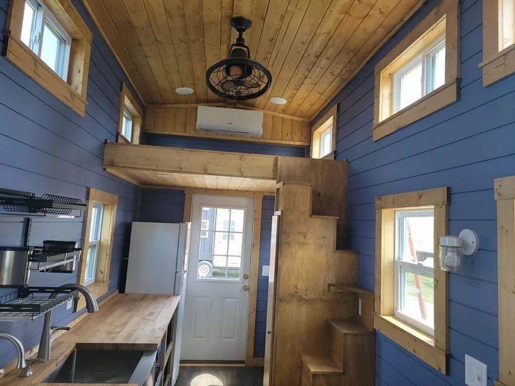 View from kitchen to front door showing small loft above door