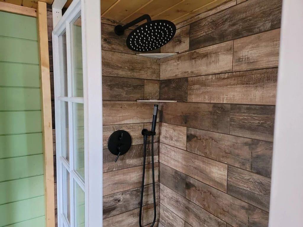 Woodgrain lined shower stall