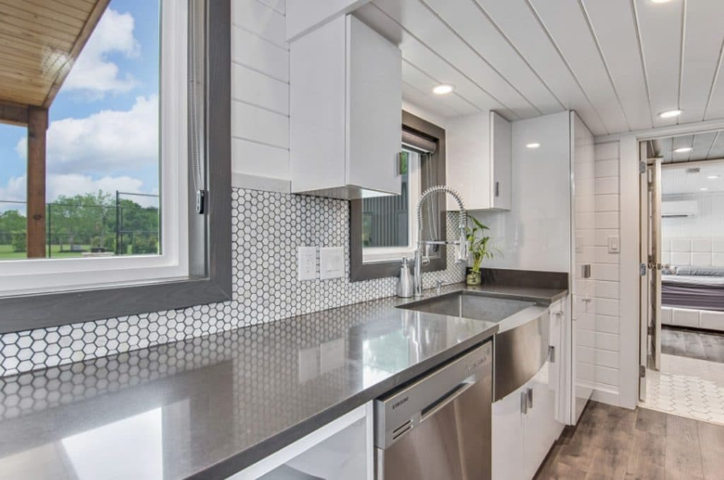 Gray countertop in kitchen with stainless steel dishwasher