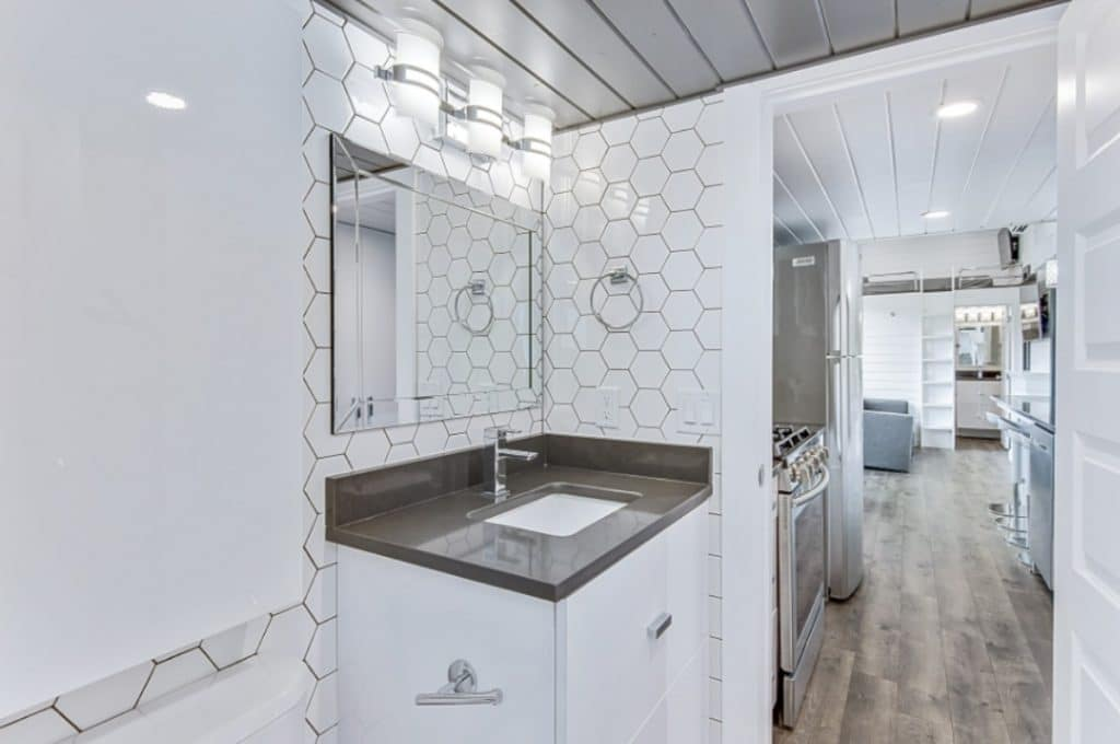 Honeycomb tile on bathroom wall with gray counter
