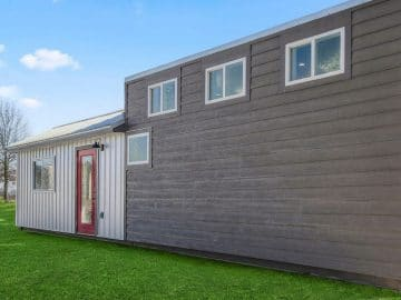 Container home with siding and loft on grass