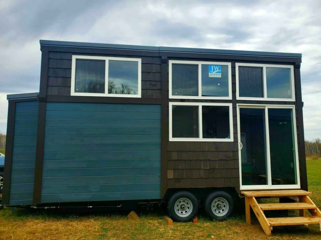Blue and gray tiny house with white trim