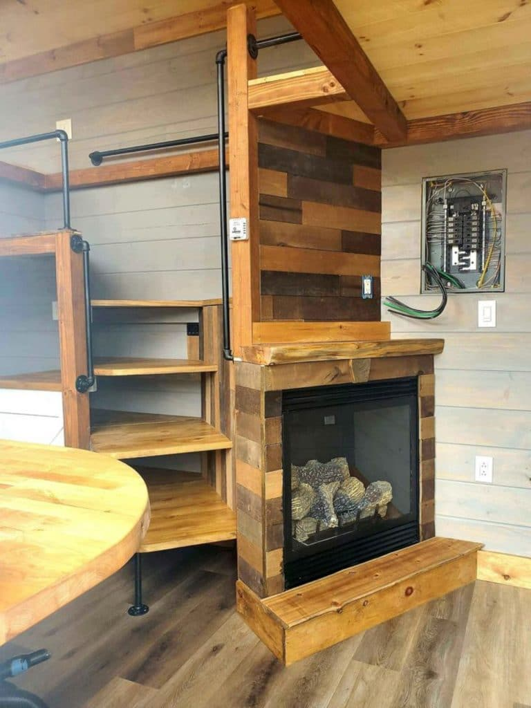 Propane fireplace against wall with reclaimed wood mantle