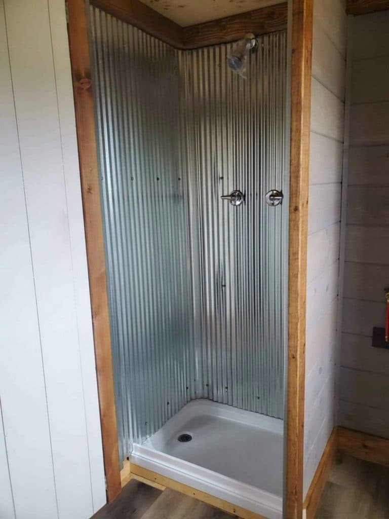 Corrugated metal surround shower in tiny home
