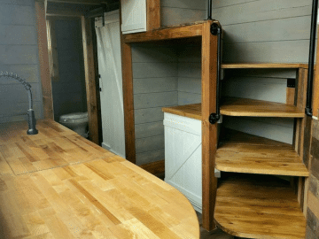 Wood counter and stairs in tiny house