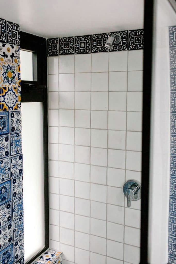 White tile shower wall