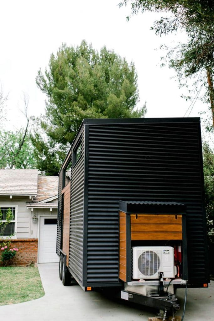 Back tow end of tiny house with black siding