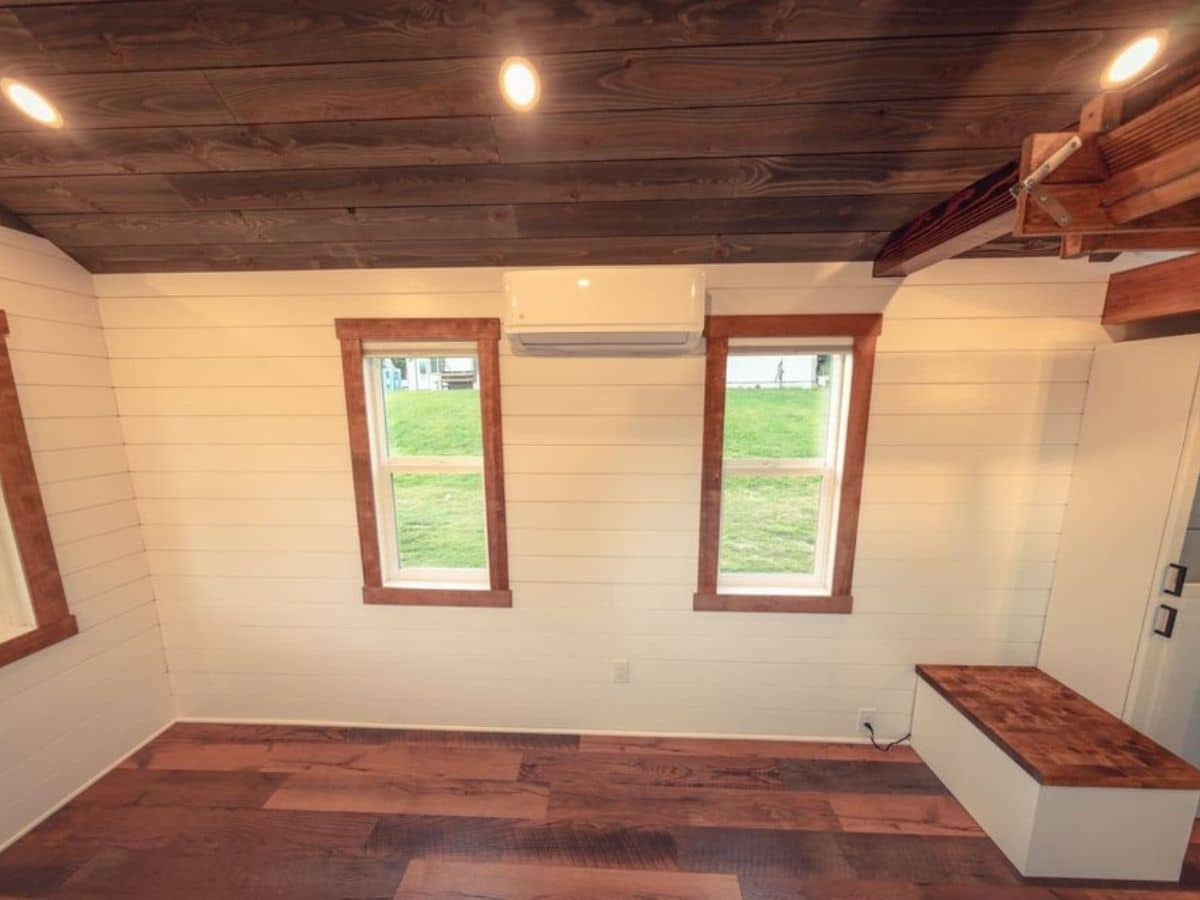 Living room with white shiplap walls and dark trim