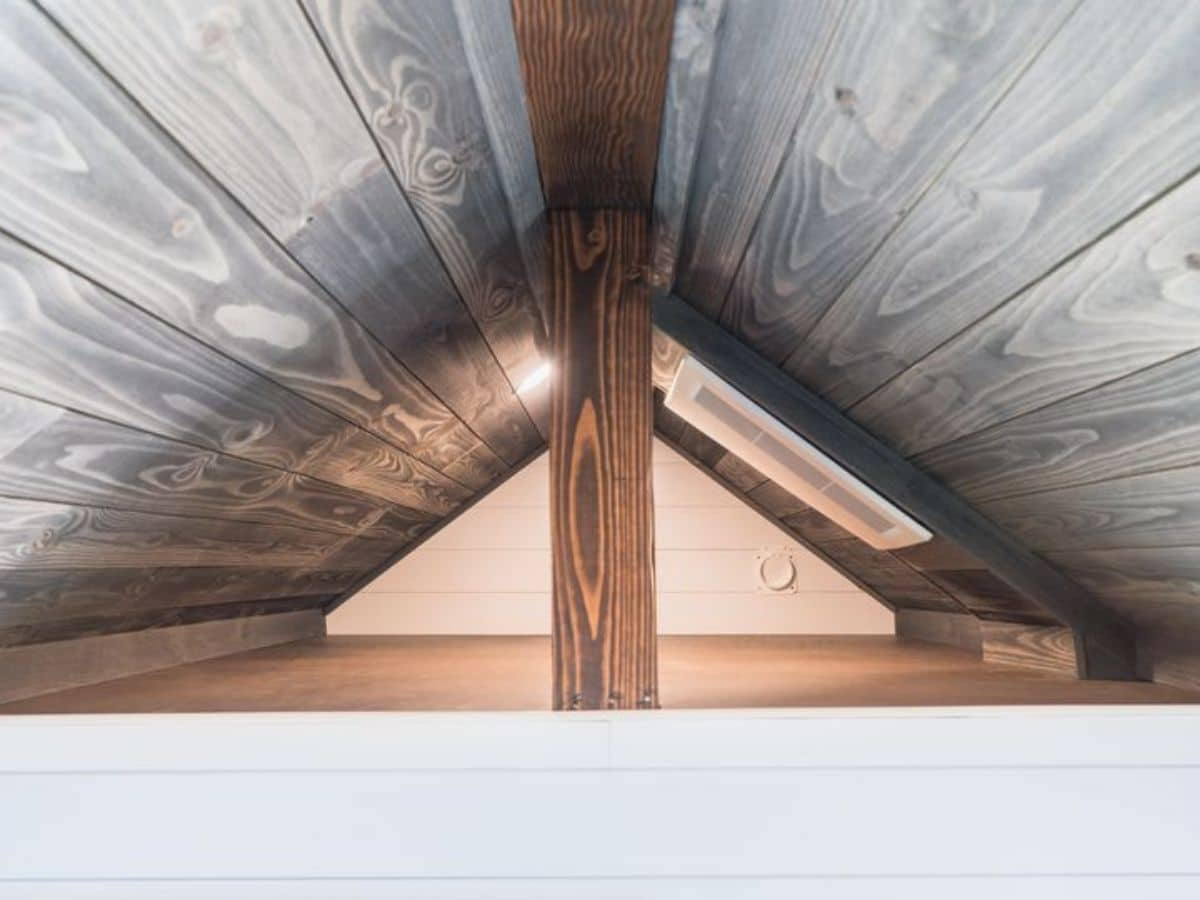 Empty small loft with wood beam in front