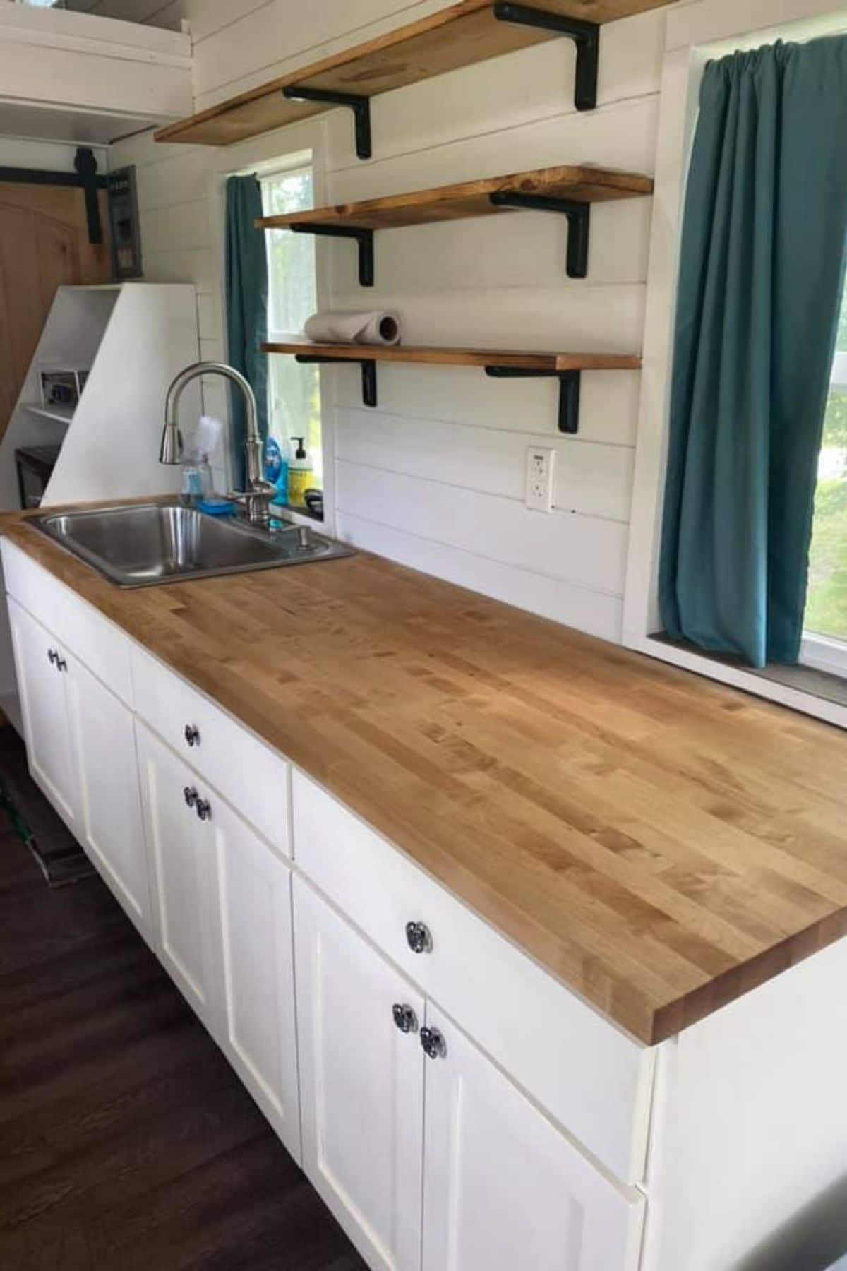 Butcher block counter with stainless steel sink and butcher block counter