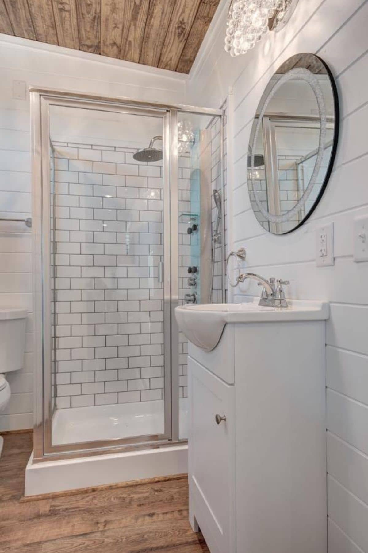 View into bathroom from door showing large shower stall with glass doors