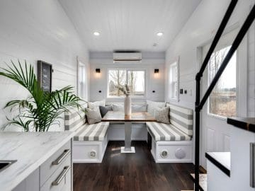 View into living area of tiny home from behind stairs